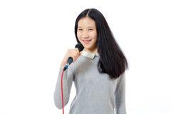 Adolescente chino con el micrófono Foto de archivo