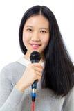 Adolescente chino con el micrófono Fotos de archivo
