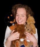 Adolescente com animais do brinquedo Imagens de Stock