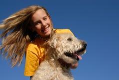 Adolescente com cão Imagens de Stock Royalty Free