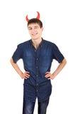 Adolescente com chifres do diabo Imagens de Stock Royalty Free