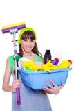 Adolescente com detergentes e espanador imagens de stock royalty free