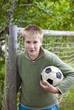 Adolescente com esfera do futebol Imagens de Stock Royalty Free