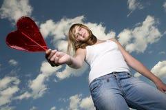 Adolescente com lollipop imagem de stock