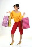 Adolescente com lotes de sacos de compra imagem de stock