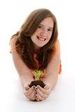 Adolescente com planta imagens de stock