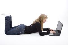 Adolescente com portátil Fotos de Stock Royalty Free