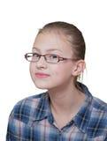 Adolescente com um olhar manhoso em sua cara imagem de stock royalty free