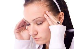 Adolescente com uma dor de cabeça imagens de stock royalty free