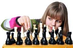 Adolescente con ajedrez Foto de archivo