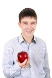 Adolescente con Apple Foto de archivo libre de regalías