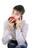 Adolescente con Apple y el teléfono móvil Imagen de archivo libre de regalías