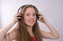 Adolescente con auriculares Fotografía de archivo