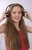 Adolescente con auriculares Imágenes de archivo libres de regalías