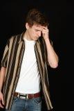 Adolescente con dolor de cabeza Imagen de archivo libre de regalías