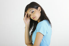 Adolescente con dolor de cabeza Imagen de archivo