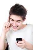 Adolescente con dos teléfonos Imagen de archivo