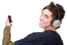 Adolescente con el auricular y el jugador mp3 Imagen de archivo libre de regalías