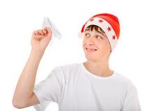 Adolescente con el avión de papel Foto de archivo libre de regalías