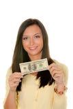 Adolescente con el billete de banco del dólar Fotografía de archivo