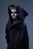 Adolescente con el cabo del cráneo del maquillaje Foto de archivo libre de regalías