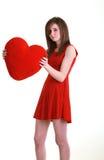 Adolescente con el corazón rojo Fotografía de archivo libre de regalías