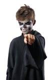 Adolescente con el cráneo del maquillaje señala el finger Fotografía de archivo libre de regalías
