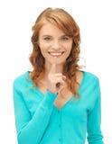 Adolescente con el dedo en los labios Fotografía de archivo