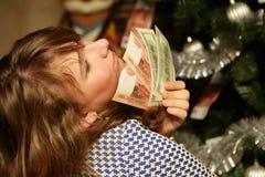 Adolescente con el dinero Fotos de archivo