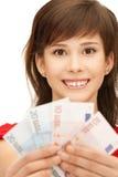 Adolescente con el dinero euro del efectivo Fotografía de archivo libre de regalías