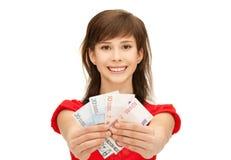 Adolescente con el dinero euro del efectivo Imagen de archivo