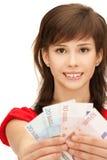 Adolescente con el dinero euro del efectivo Fotografía de archivo