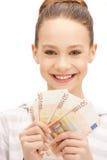 Adolescente con el dinero euro del efectivo Imagen de archivo libre de regalías