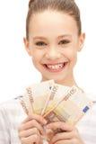 Adolescente con el dinero euro del efectivo Fotos de archivo
