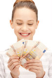 Adolescente con el dinero euro del efectivo Imagenes de archivo