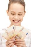 Adolescente con el dinero euro del efectivo Foto de archivo libre de regalías