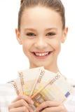Adolescente con el dinero euro del efectivo Fotos de archivo libres de regalías