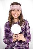 Adolescente con el espejo Imagen de archivo