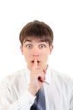 Adolescente con el finger en sus labios Fotografía de archivo libre de regalías