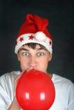 Adolescente con el globo rojo Imagen de archivo