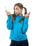 Adolescente con el lápiz labial sobre blanco Fotos de archivo