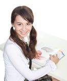 Adolescente con el libro Imagen de archivo