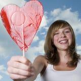 Adolescente con el lollipop Fotografía de archivo libre de regalías