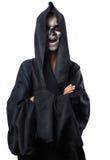 Adolescente con el maquillaje del cráneo en capa negra ríe Foto de archivo libre de regalías