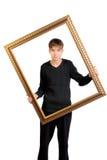 Adolescente con el marco Fotografía de archivo