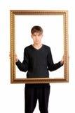 Adolescente con el marco Imagenes de archivo