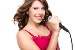 Adolescente con el micrófono Imagen de archivo libre de regalías