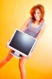 Adolescente con el monitor - 4 Imágenes de archivo libres de regalías