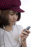 Adolescente con el MP3 Imágenes de archivo libres de regalías