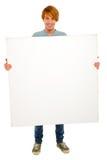 Adolescente con el panel blanco Imagen de archivo